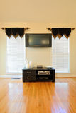 Entertainment System. Modern flat screen TV and entertainment system in a home interior Royalty Free Stock Images
