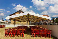 Entertainment tent with red chairs Stock Photography