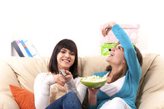 Entertainment with TV. Smiling and happy girls Royalty Free Stock Photo