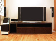 Entertainment unit. Home entertainment unit with plasma TV and surround speakers Stock Image