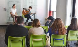 Musician playing at student art show Stock Photography
