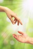 Entfaltete Hand für Hilfe Stockfotos