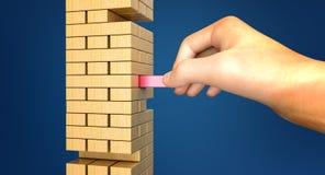 Entfernen eines Blockes vom Turm von Blöcken Lizenzfreies Stockfoto