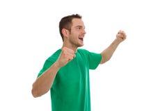 Enthousiaste jonge die mens in groen op wit wordt geïsoleerd. Royalty-vrije Stock Foto's