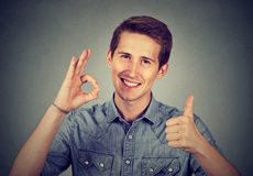 Enthusiast man with thumbs up ok hand gesture Stock Photography