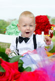 Enthusiastic baby boy at festive table Royalty Free Stock Photos