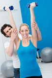 Enthusiastic beautiful woman working out Stock Photo