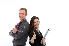 Enthusiastic business colleagues giving thumbs up Stock Images
