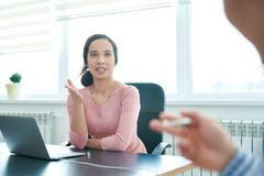 Enthusiastic business lady discussing agenda with colleague royalty free stock photos