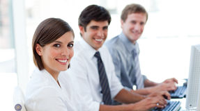 Enthusiastic business people working at computers Royalty Free Stock Photo