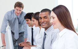 Enthusiastic business team working at computer Stock Image