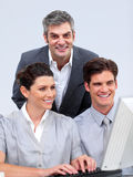 Enthusiastic business team working at a computer Stock Images