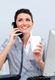 Enthusiastic business woman on phone Stock Image