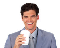 Enthusiastic businessman drinking a coffee Royalty Free Stock Photos