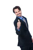 Enthusiastic businessman giving a thumbs up Stock Image