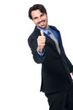 Enthusiastic businessman giving a thumbs up Stock Photography