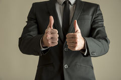 Enthusiastic businessman making a double thumbs up Royalty Free Stock Photography