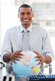 Enthusiastic businessman showing a globe Royalty Free Stock Image