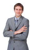 Enthusiastic businessman standing with folded arms Royalty Free Stock Photos