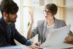Enthusiastic Businesswoman Discussing Documentation with Colleag Royalty Free Stock Photo