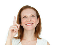 Enthusiastic businesswoman pointing at a copyspace Royalty Free Stock Photography
