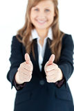 Enthusiastic businesswoman with thumbs up Royalty Free Stock Images