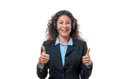 Enthusiastic businesswoman wearing a headset Stock Images