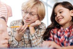 Enthusiastic children studying human anatomy Stock Photos