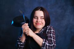 Enthusiastic cooker young attractive woman smiling standing with royalty free stock photos