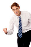 Enthusiastic corporate man clenching fist Royalty Free Stock Images