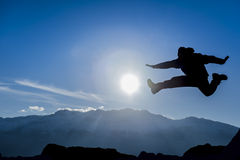 Enthusiastic & dynamic. Action silhouette. crazy mountaineer and dynamic man royalty free stock photo