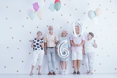 Enthusiastic elderly people with colorful balloons celebrating f. Riend`s birthday stock image
