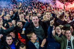 Enthusiastic fans party the victory of their football club Stock Photo