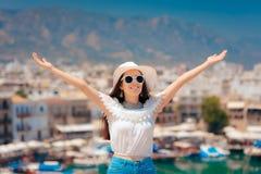 Happy Travel Girl Rising Arms Enjoying Summer Holiday. Enthusiastic female tourist enjoying wonderful panoramic view stock photo