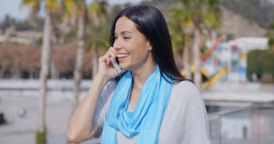 Enthusiastic female using phone outdoors Royalty Free Stock Images