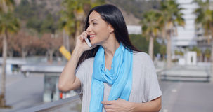Enthusiastic female using phone outdoors Royalty Free Stock Photo