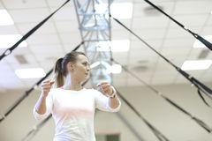 Enthusiastic fitness trainer on background of resistance bands Royalty Free Stock Photography