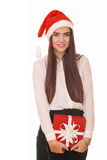 Enthusiastic girl in christmas hat Royalty Free Stock Image
