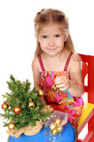 Enthusiastic girl dresses up Christmas tree Royalty Free Stock Photo