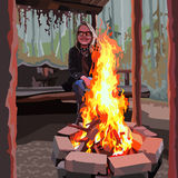 Enthusiastic girl with glasses sitting around a bonfire Royalty Free Stock Image