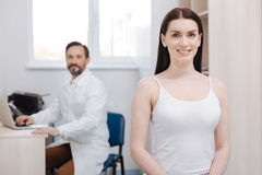 Enthusiastic graceful woman visiting plastic surgeon for lifting procedure stock photography