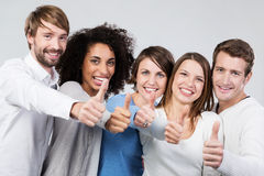 Enthusiastic group of people giving a thumbs up Royalty Free Stock Photo