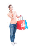 Enthusiastic and happy woman holding shopping bags Royalty Free Stock Photography