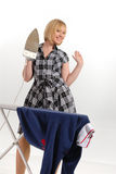 Enthusiastic housewife ironing Royalty Free Stock Photography
