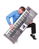 Enthusiastic keyboard player Stock Images