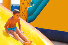Enthusiastic kid on slide Stock Photos