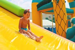 Enthusiastic kid on slide Royalty Free Stock Photography