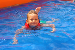 Enthusiastic kid in vest at the pool Royalty Free Stock Photos