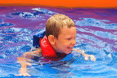 Enthusiastic kid in vest at the pool Royalty Free Stock Photo