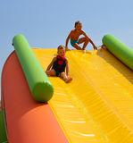 Enthusiastic kids on slide royalty free stock image